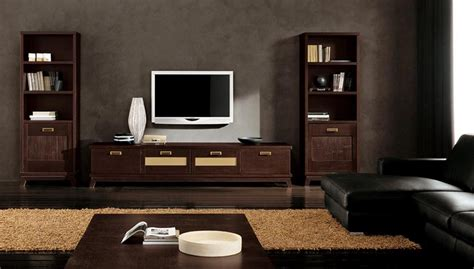 modern ethnic living room with small tv stand and two storage wooden floor black sofa and lcd tv