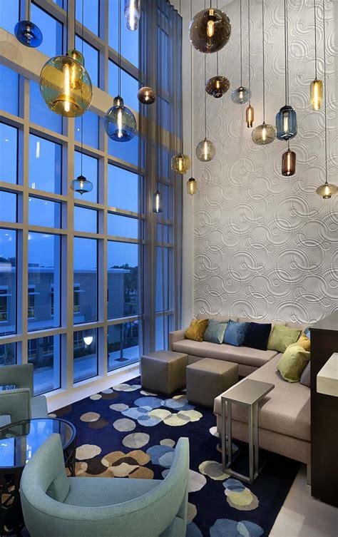 modern hotel lighting adorns lobby of hilton resort in