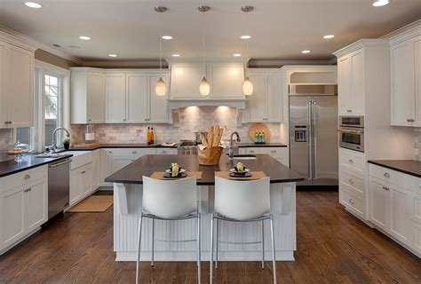 best kitchen layouts with island island vs peninsula which kitchen layout serves you best