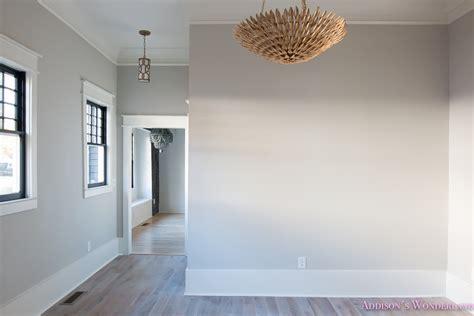 living room light gray walls grey gold chandelier black window sashes whitewashed hardwood