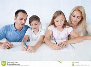 Parents Helping Their Children With Their Homework Stock ...