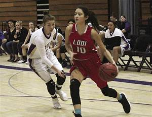 Girls basketball: Flames slip past Tigers in rivalry ...