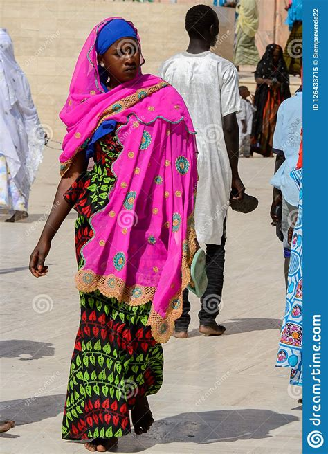 Unidentified Senegalese Woman In Colored Traditional