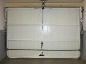 Ou trouver une porte de garage basculante pas cher en for Porte de garage basculante pas cher