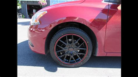 2013 nissan sentra with 17 inch red black rims tires