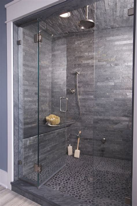 cave bathroom ideas this shower cave pebble flooring and