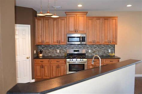 storage kitchen cabinets charleston toffee kitchen cabinets modern cedar rapids 2562