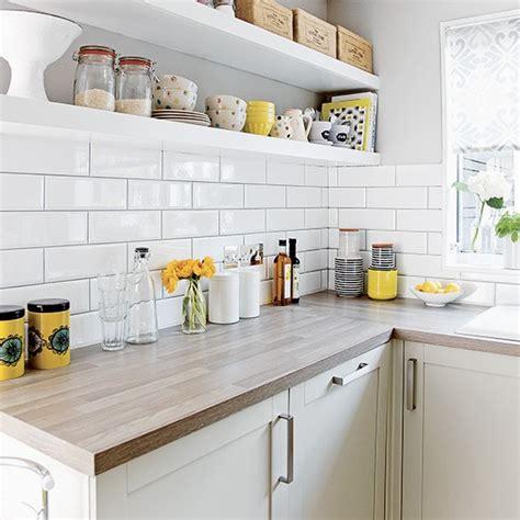 white metro tiles kitchen white kitchen with metro tiles and open shelves 1439