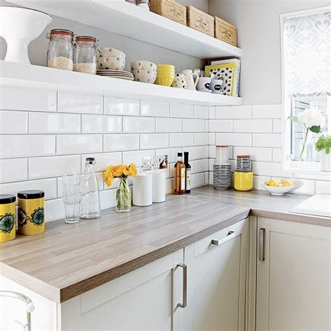 White Kitchen With Metro Tiles And Open Shelves