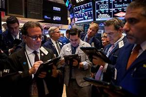 Global stocks fluctuate after Fed rate hike, dollar rises ...
