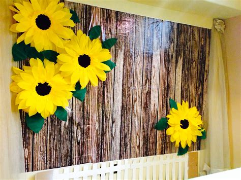 giant crepe paper sunflowers cardboard picket fence