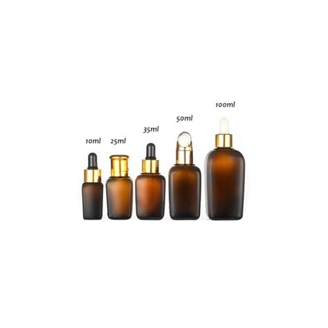 A free sample mockup (full version) showing a floating dropper bottle. 30ml 50ml 100ml Luxury amber essential oil glass dropper ...