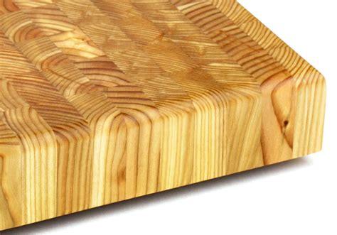larch wood square  grain cutting board  cutlery