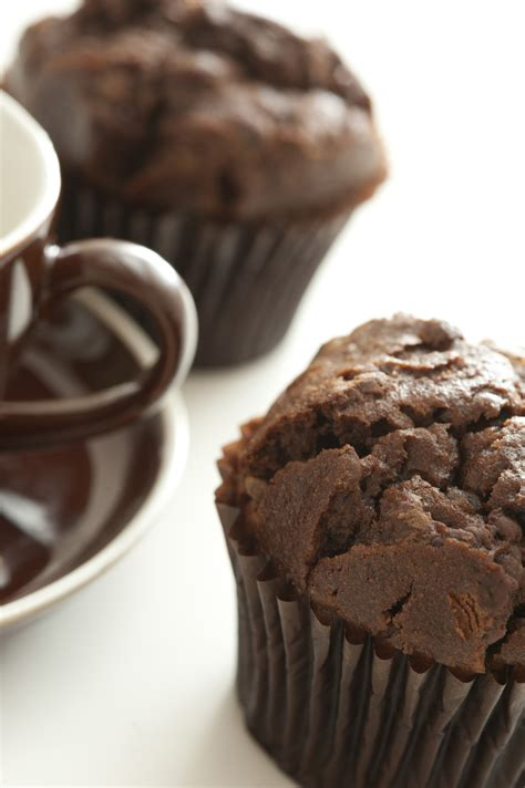 freshly baked chocolate muffins  coffee cup