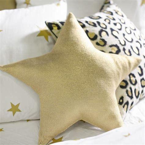 emily  meritt liquid gold star pillow