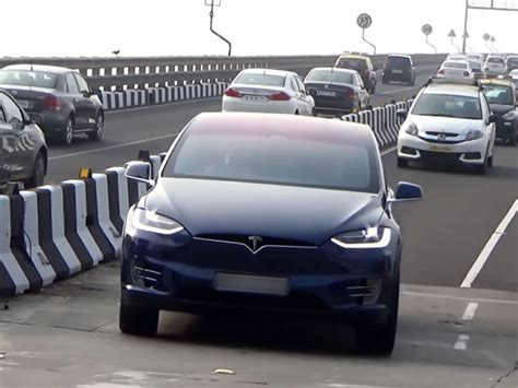 Get Tesla Car On Road Price In India Background
