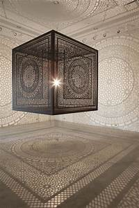 Intersections an ornately carved wood cube projects for Intersections an ornately carved wood cube projects shadows onto gallery walls