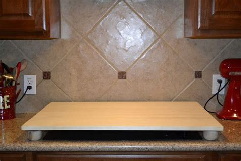 How To: Stove Top Cover for Added Buffet Space. I would