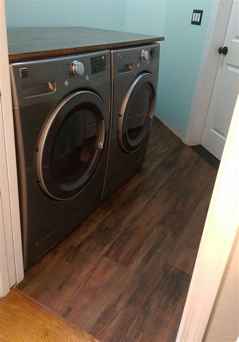 linoleum flooring laundry room transform your laundry room floor with faux wood vinyl flooring hometalk