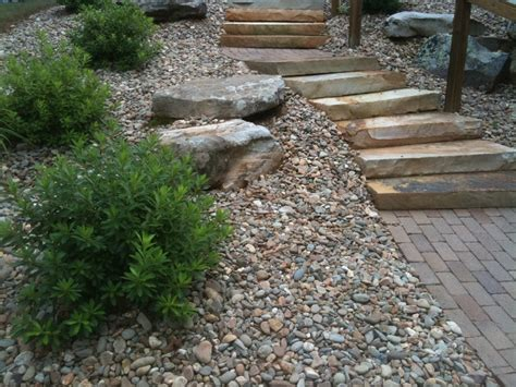 using boulders in landscaping newnan landscape supplies using boulders in your landscape mulch and more landscape