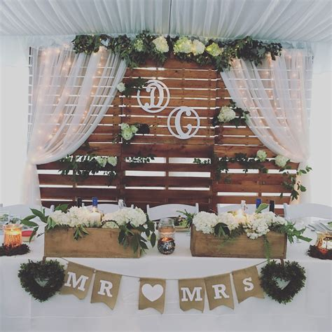 rustic head table and backdrop wooden backdrop wedding