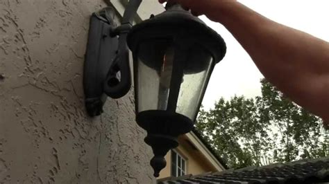 how to change an outdoor porch lantern sconce light bulb