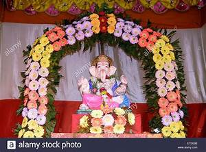 Idol of Lord Ganesh kept in gaily decorated frame of