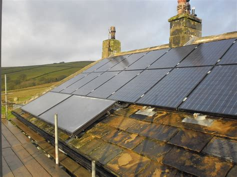 re roofing stone slate roof installing fixings for solar