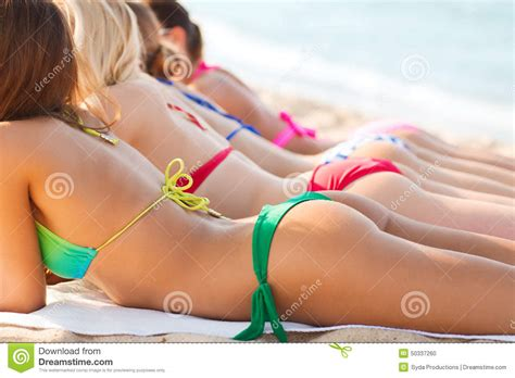 Close Up Of Young Women Lying On Beach Stock Photo Image