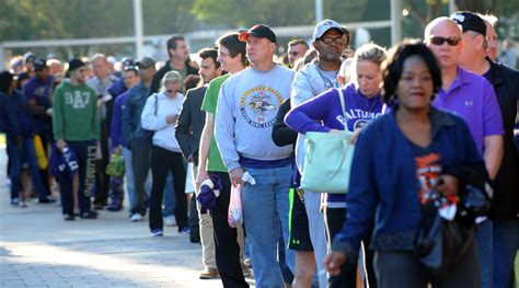 fan sun line t fans line up to turn in their rice jerseys at m t bank stadium baltimore sun