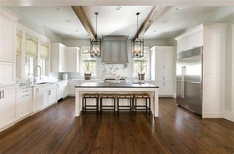 shaped kitchen  wood ceiling beams transitional
