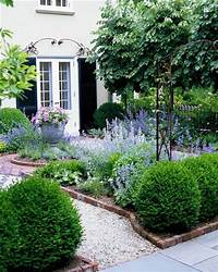 lovely gravel garden design Boxwood + lavender or nepeta and maybe russian sage ...