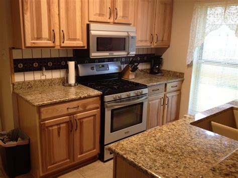honey oak cabinets with black granite countertops