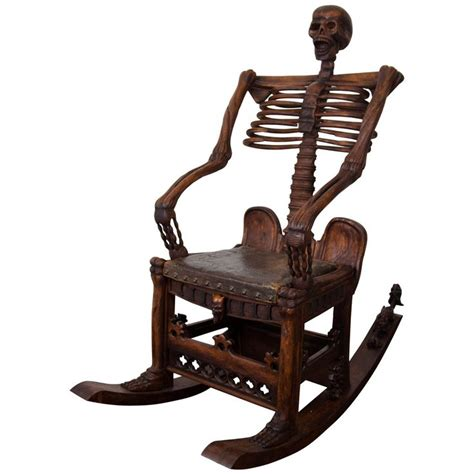 an antique carved skeleton rocking chair rocking