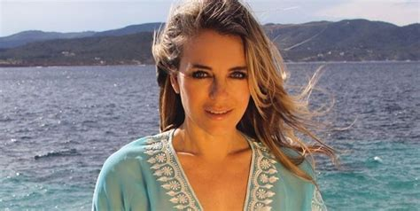 elizabeth hurley wears swimming coverup  abs baring