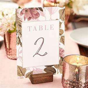 Tie back to your wedding theme with hand-lettered table ...