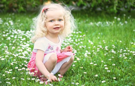 Little Girl Is Sitting On Green Meadow Wallpapers