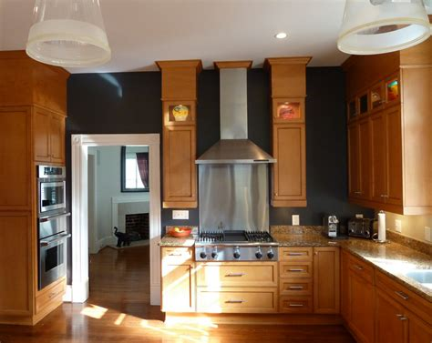 wall color for oak cabinets black walls in the kitchen with oak cabinets needs a lot