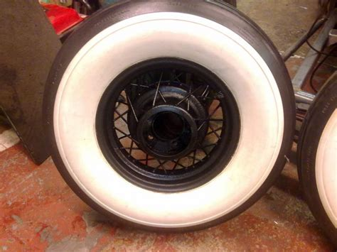 pair    ford wire wheels   whitewalls