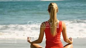 the high female fitness woman meditating on the beach royalty free video and
