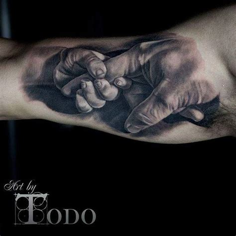 baby holding dads finger realistic tattoo  bicep  todo