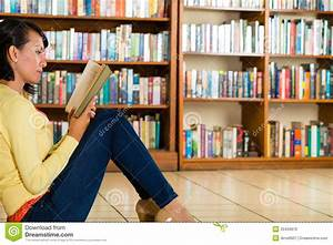 Young Girl In Library Reading Book Royalty Free Stock ...