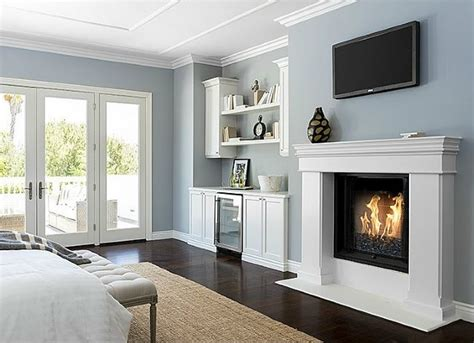 blue bedroom with fireplace
