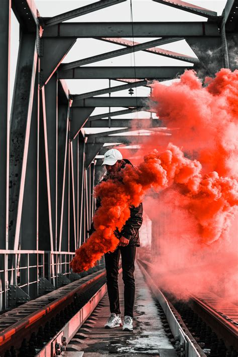 hooded figure holding red flare  stock photo