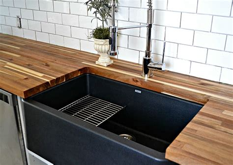 blanco silgranit farmhouse sink a black farmhouse sink gives our country kitchen a warm feel