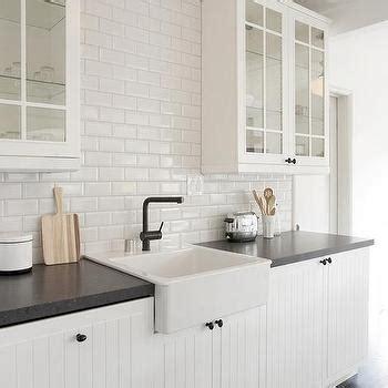 white  black kitchen  glass upper cabinets