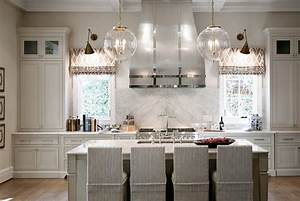 Warm white kitchen design gray butlers pantry home for Kitchen colors with white cabinets with metal chandelier wall art