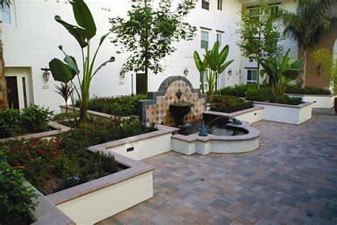 smooth stucco wall  capstone landscape design
