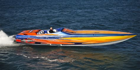 Yellow Cigarette Boat by Lip Ship Performance Cigarette Racing Team