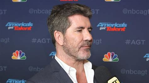 exclusive simon cowell gushes  son backstage